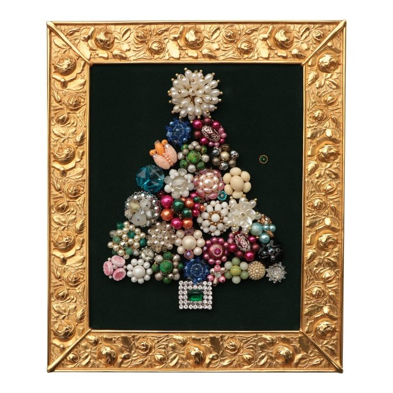 Christmas tree collage created from carefully-selected vintage costume jewelry pieces in a variety of colors set against dark green velour. Framed in a vintage 18kt gold-plated Elias Artmetal frame with blooming roses and an easel back.