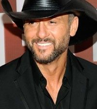 """NASHVILLE, Tenn. (AP) - Tim McGraw will be saluting veterans in a big way while on tour this summer.    The country music superstar is giving away 25 mortgage-free houses -- one for each stop on his upcoming """"Brothers of the Sun"""" tour with Kenny Chesney -- to wounded or needy service members."""
