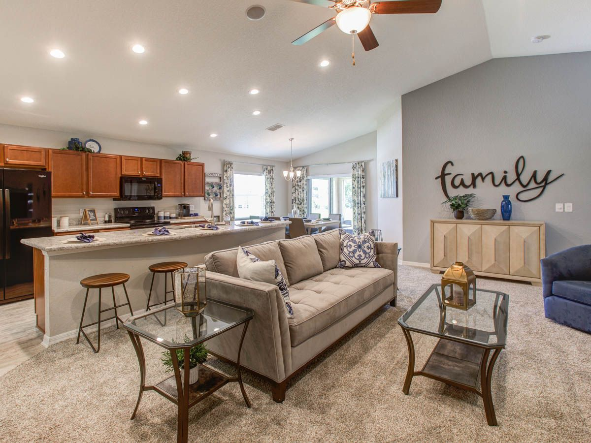 Volume Ceilings Add To The Open Feel In This Highland Homes Parker Model Home In St Cloud Fl Newhome Greatroom Highland Homes New Homes Home