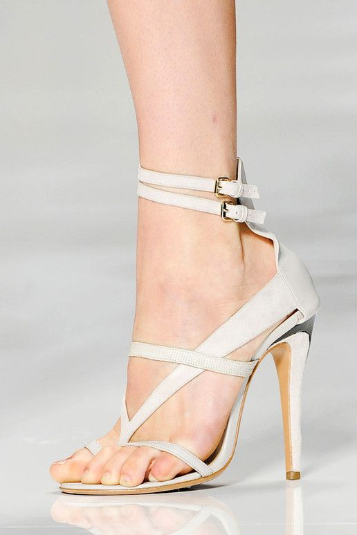 high heeled sandals w/ thongs are easier to wear because they prevent the foot sliding forward!