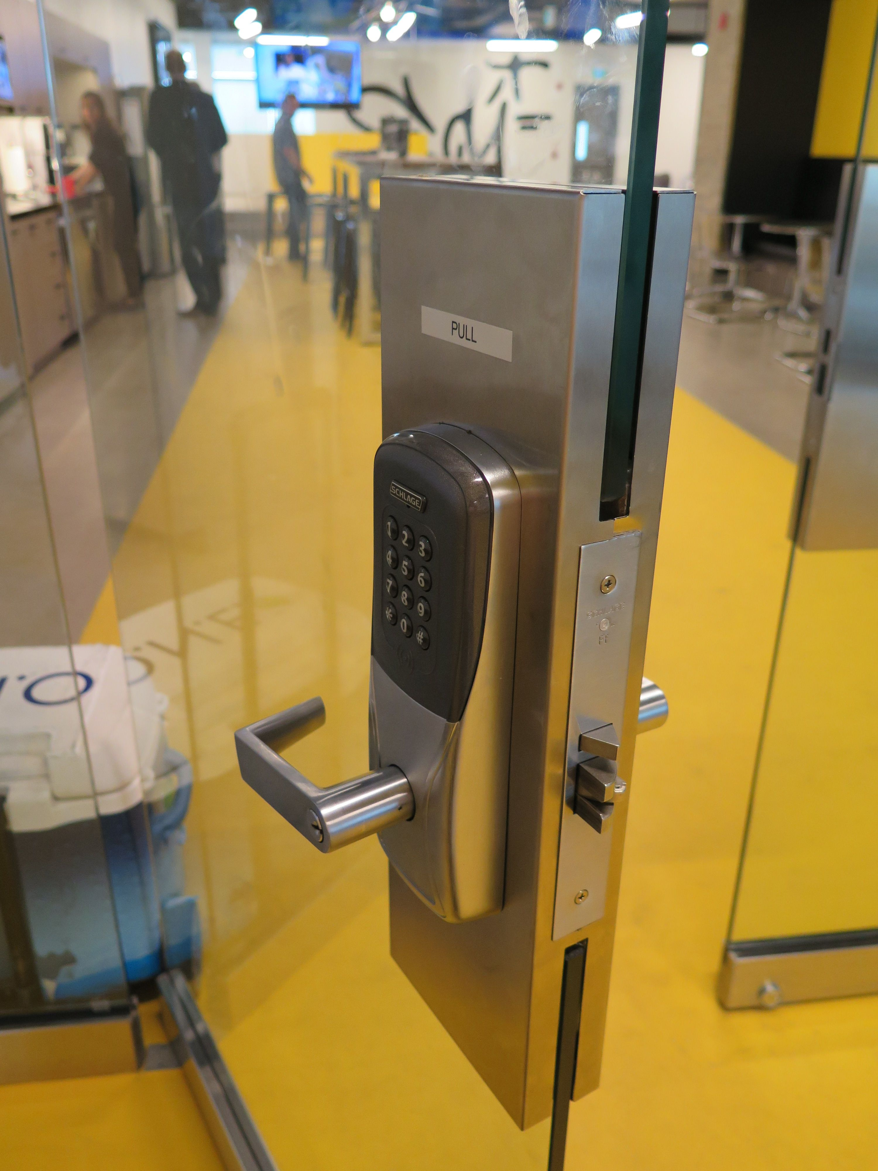 Schlage ad400 lock installed on a frameless all glass doors at sdi lock installed on a frameless all glass doors at sdi marketing installed by phoenix lock and security eventelaan Gallery