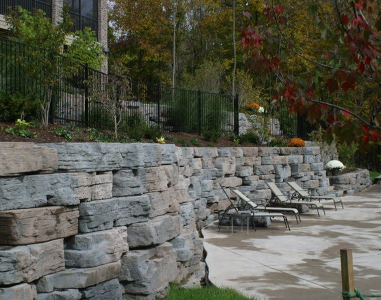 Outcropping Stone Retaining Wall Retaining Wall Fence Landscaping