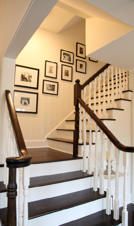 Love this entry staircase with art gallery in black gallery frames ...