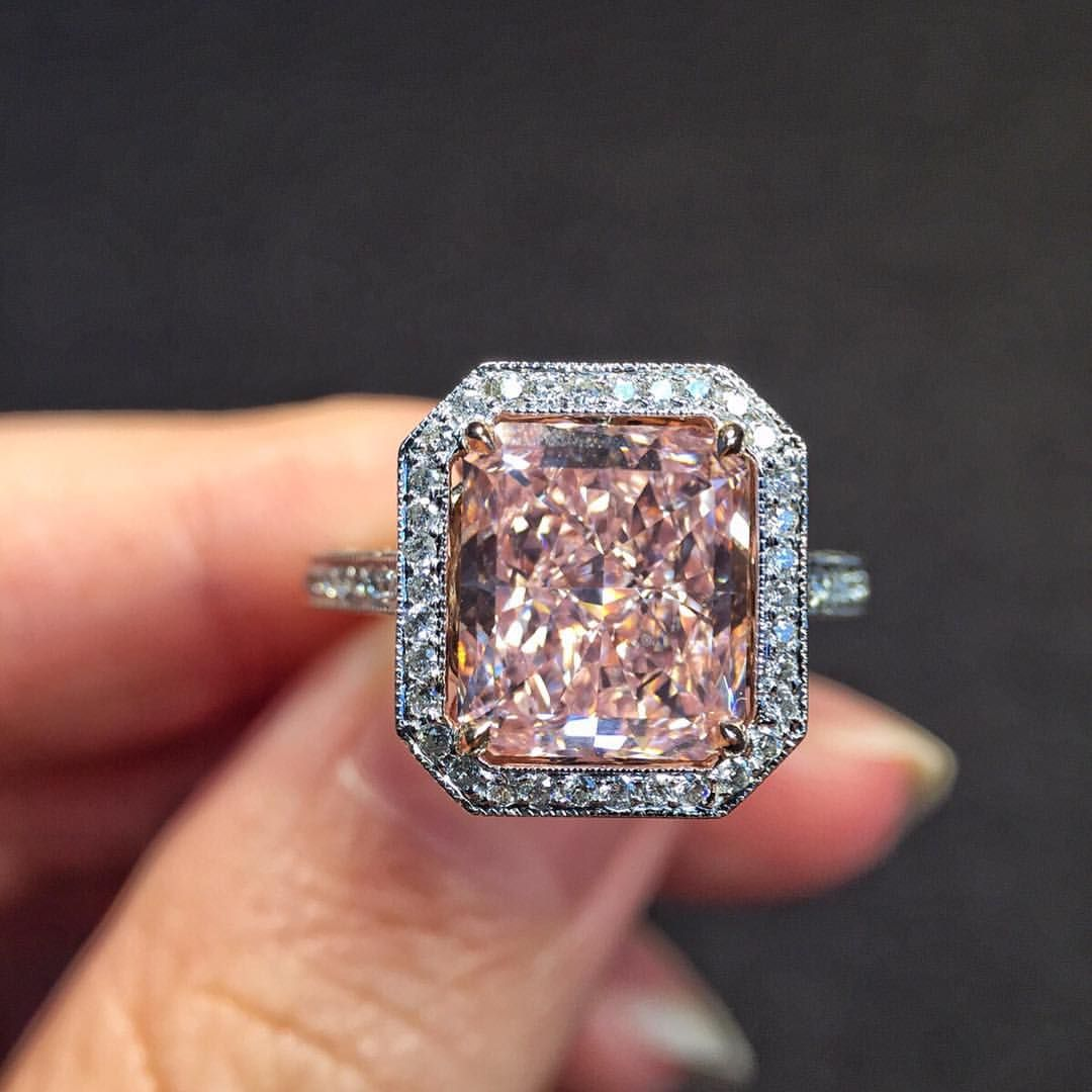 A spectacular 3 49 vvs2 radiant cut fancy intense pink diamond ring surrounded by micros set white