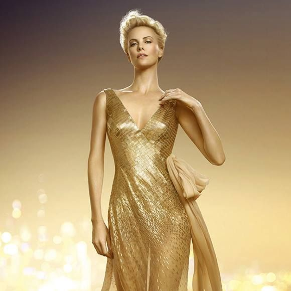 Charlize Theron sporting a brand new glittering gold dress in the ...