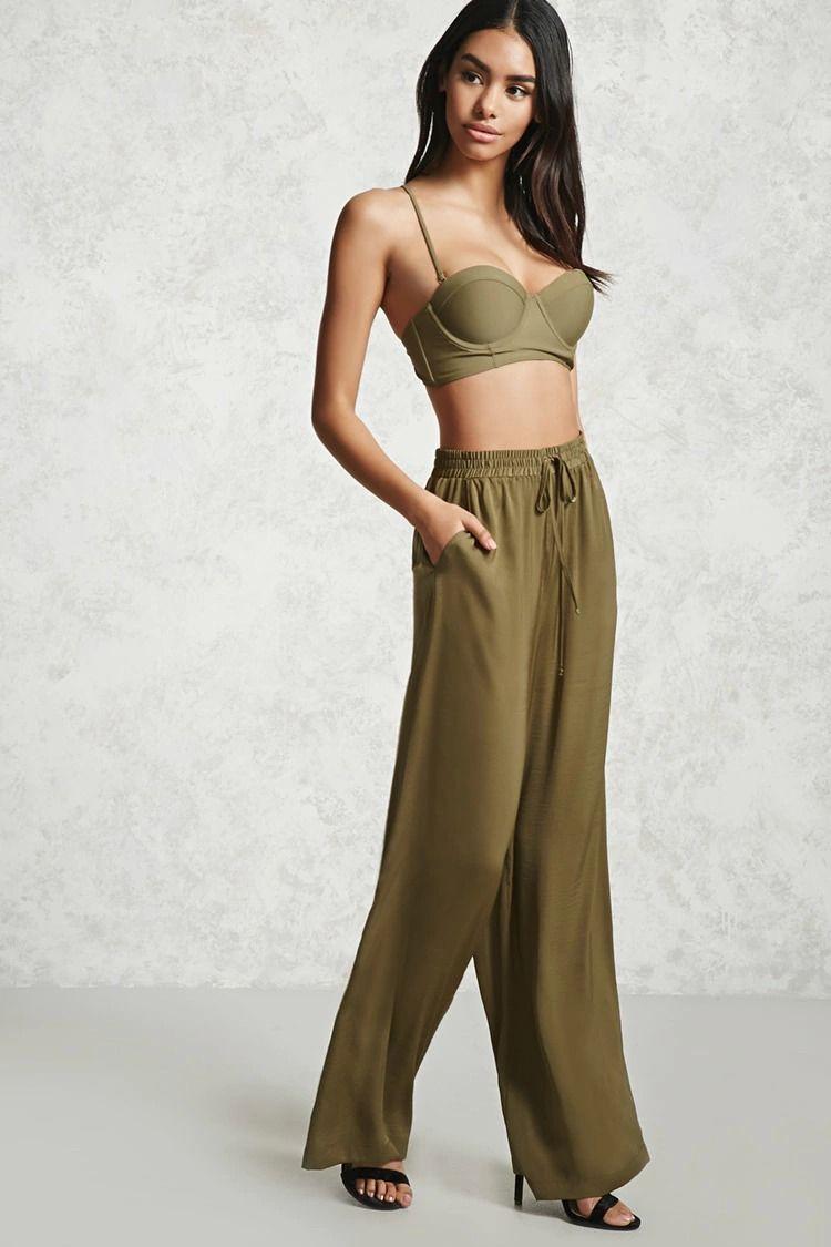 f2111e5aa3134 A pair of satin palazzo pants featuring an elastic drawstring waist ...