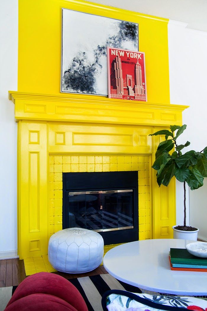 bright yellow fireplace in kids' playroom via @gwe