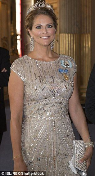 Sticking with tradition: Princess Madeleine of Sweden chose to wear a tiara for the occasi...