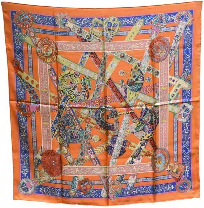 """Hermes, """"Le Songe de la Licorne"""" Silk Scarf in Orange : Lot 87. GORGEOUS Hermes le songe de la licorne silk scarf in excellent condition. Original silk screen design by Anne Faivre c2015. Limited edition design no longer available as a silk 90cm scarf making this a rare collectors piece. 100% silk, hand rolled hem, made in France, original tag attached. Measurements: 35""""x35"""" Hermes scarf box included."""