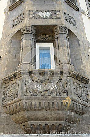 Year 1903, a stucco molding on a house balcony