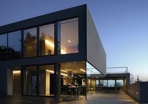 12 Modern House with Black Exteriors: Aatrial House by Polish firm KWK  Promes Architects is