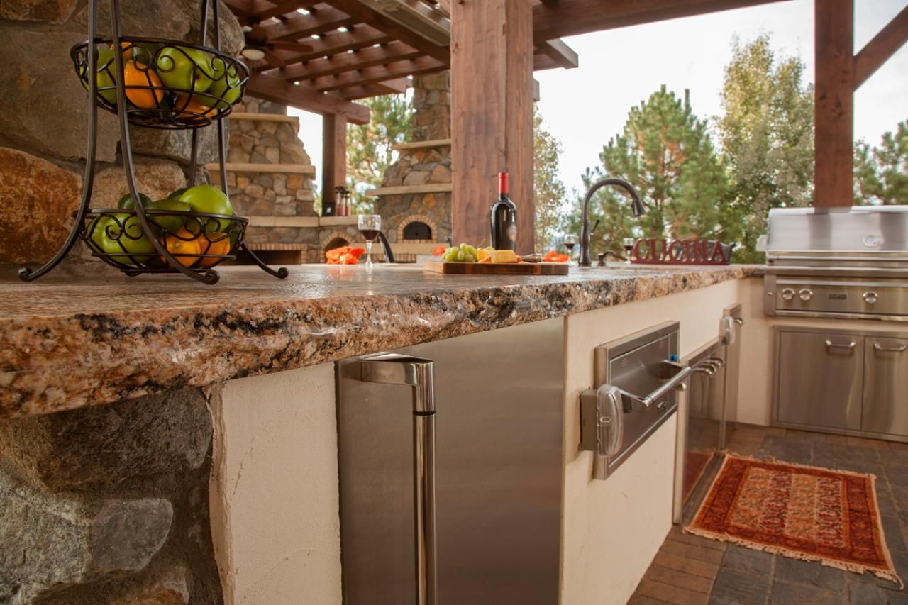 Superbe Raw Edge Granite Countertops In Rustic Outdoor Kitchen | HGTV