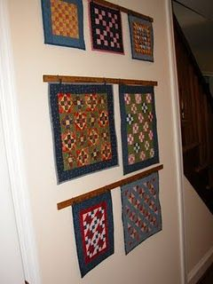 Using Vintage Yardsticks To Hang Little Quilts On The Wall