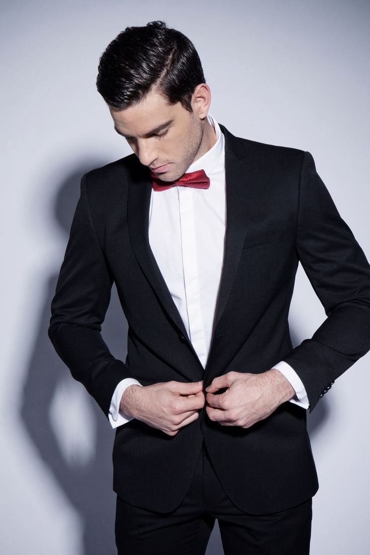 Classic black suit with red bow tie