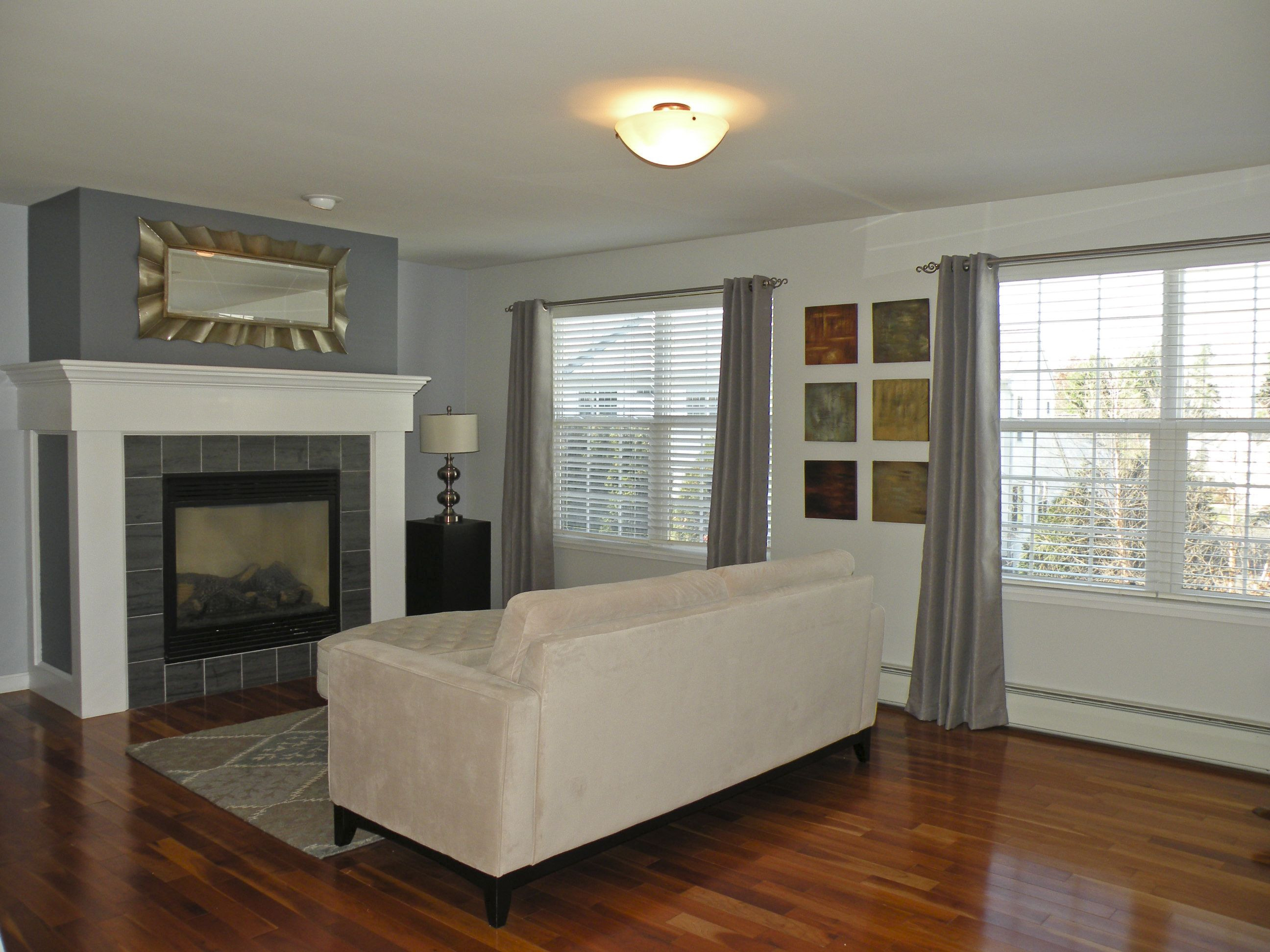 Superior Sunny Living Room With Fireplace And Beautiful Hardwood Floor