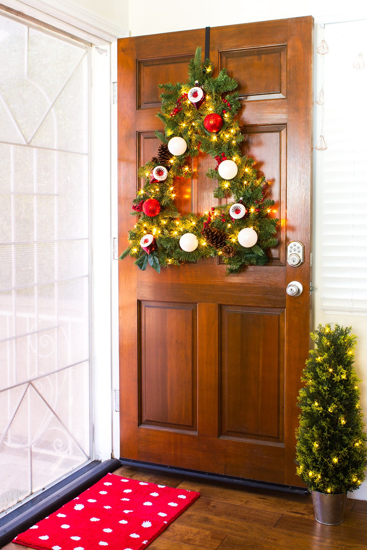 Christmas Tree Shaped Wreath For Your Front Door Sarahhearts Christmas Front Doors Christmas Door Decorations Front Door Decor