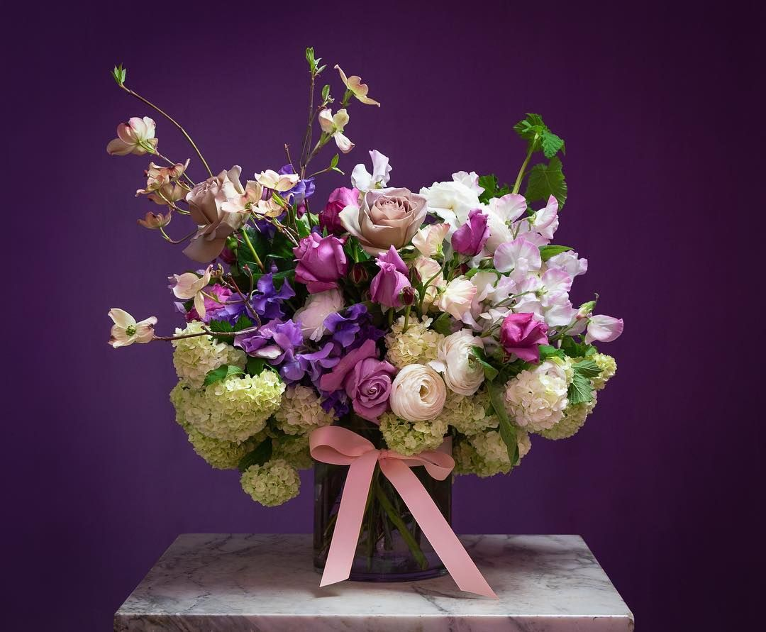 Purple And Pink Spring Flowers By Flowers Vasette Includes Dogwood Snowballs Lilac Roses And Sweet Pink Spring Flowers Fresh Flower Delivery Flower Delivery