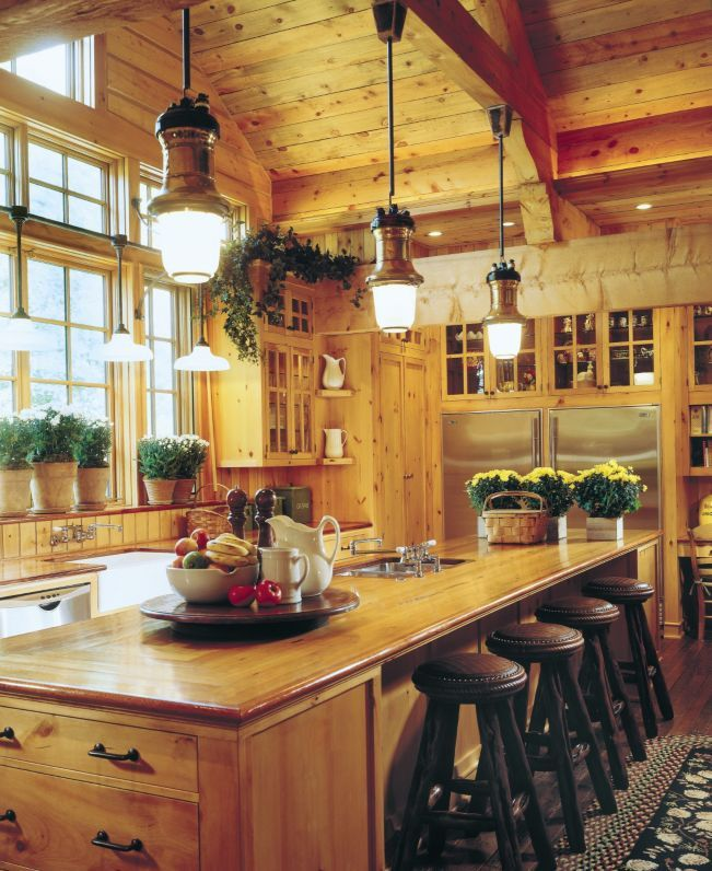 warm and cozy this kitchen's vaulted ceiling and windows