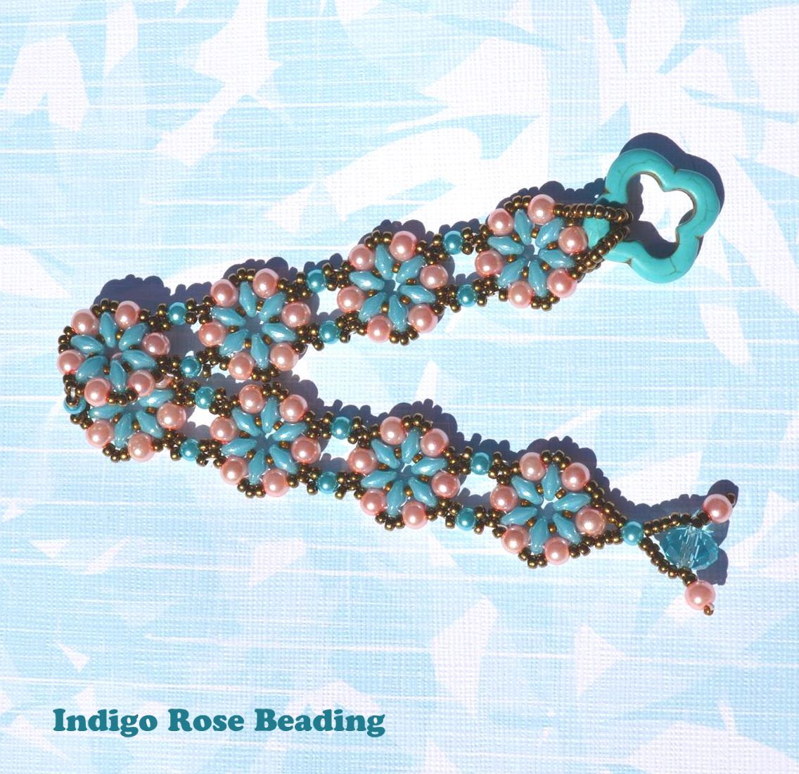 """I made this bracelet using Donna Sanders """"Petals & Pearls"""" bracelet pattern. I changed it a little using 15mm beads between the superduos and using a round bead instead of a superduo in the connection pieces."""