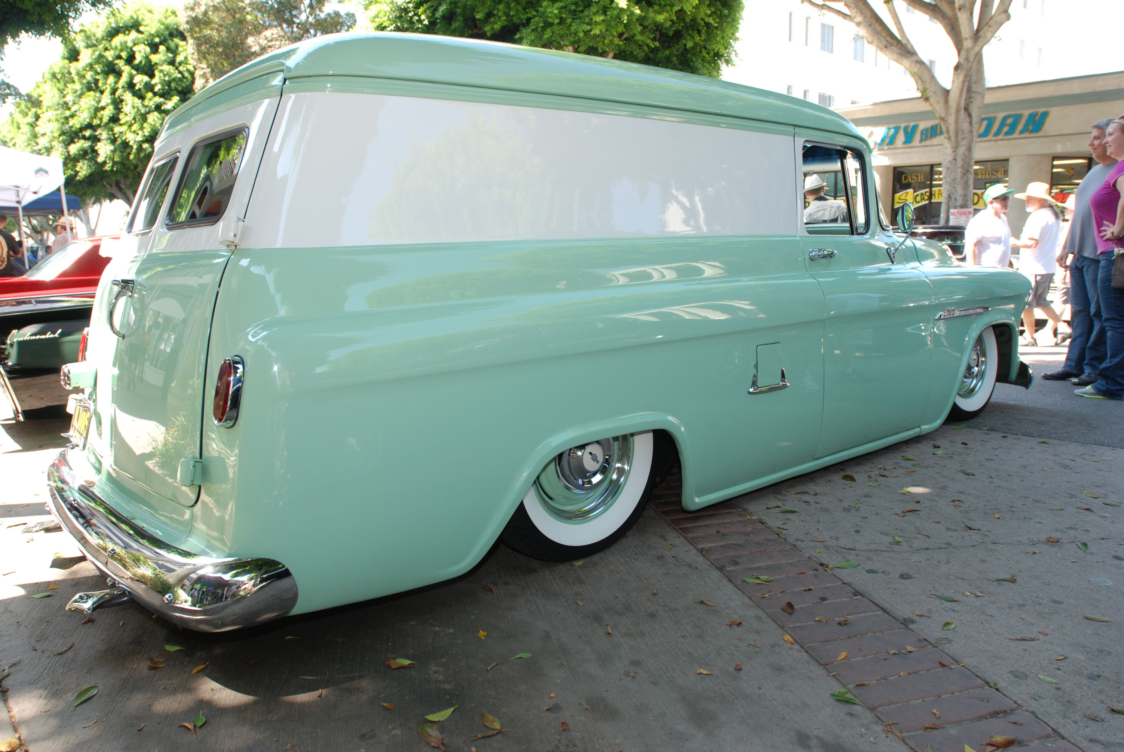Seafoam Green Paint Reflection In The Side Of Black 1963 Lincoln Continental Parked To