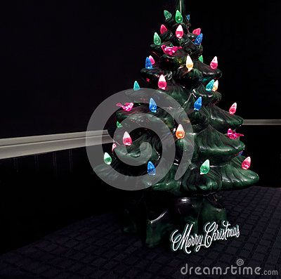 A lighted, ceramic Christmas tree for holiday decorating.