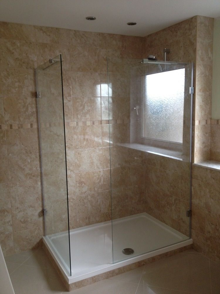 Shower cubicle with glass panels in sandy coloured bathroom | luxury ...