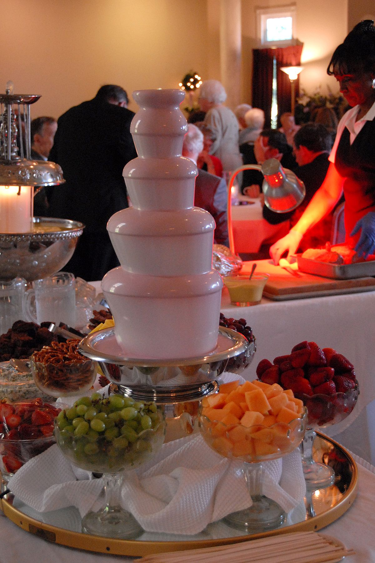 Pink Chocolate Fountain And Yummy Hors D Oeuvrs During An Evening Wedding Reception At Green