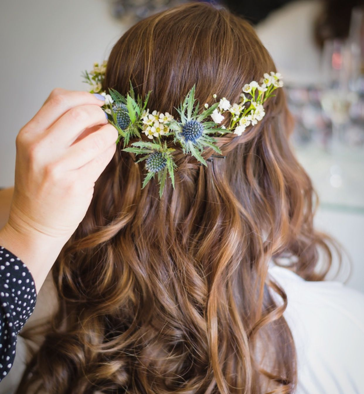 wedding hair half up half down decorated with thistles