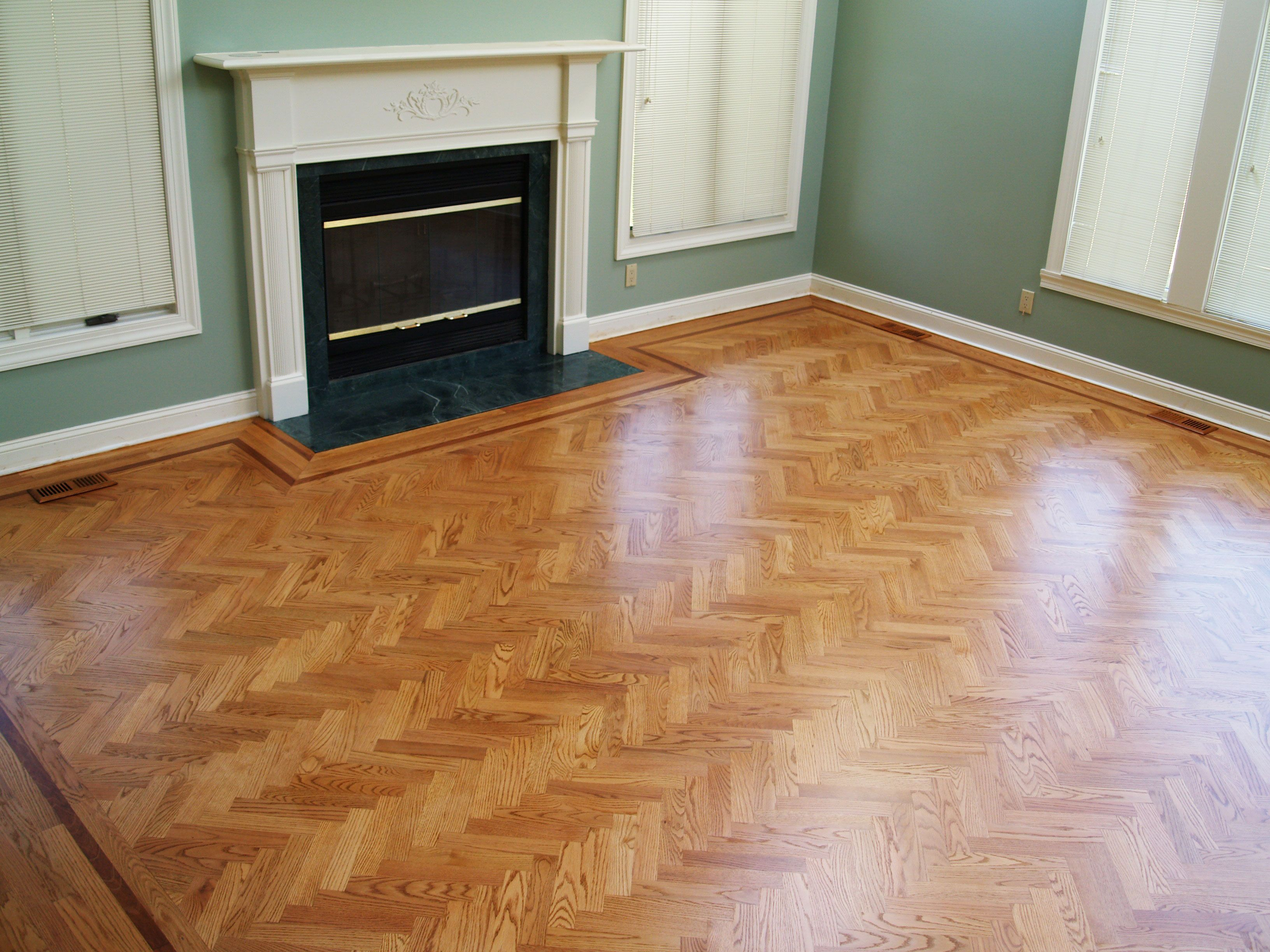 Herringbone red oak flooring with feature strip borders