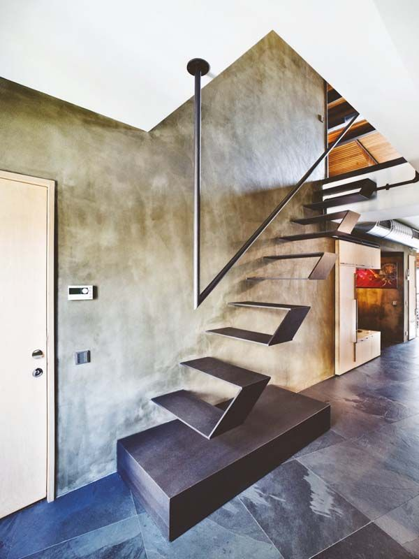 Modern industrial bachelor pad infused with warmth in Istanbul - cortenstahl innenbereich ideen