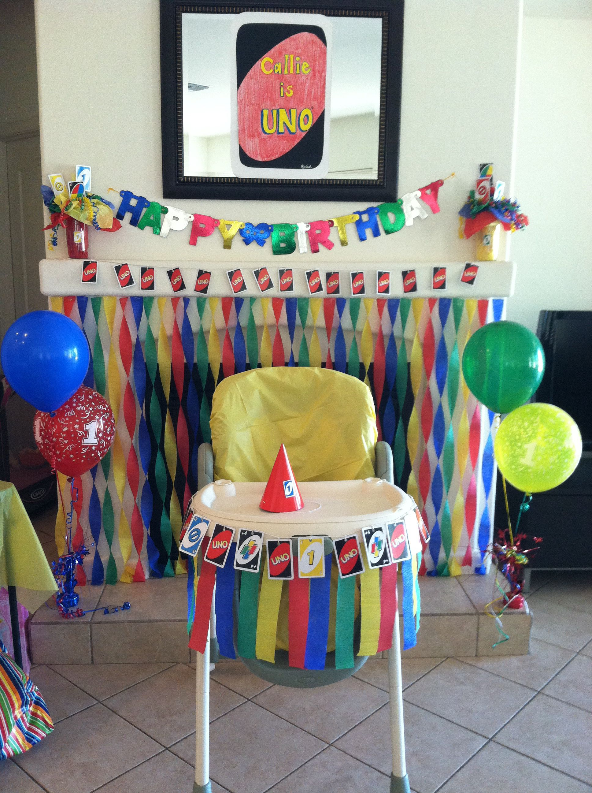 Uno themed decor, shows high chair decor idea and backdrop great
