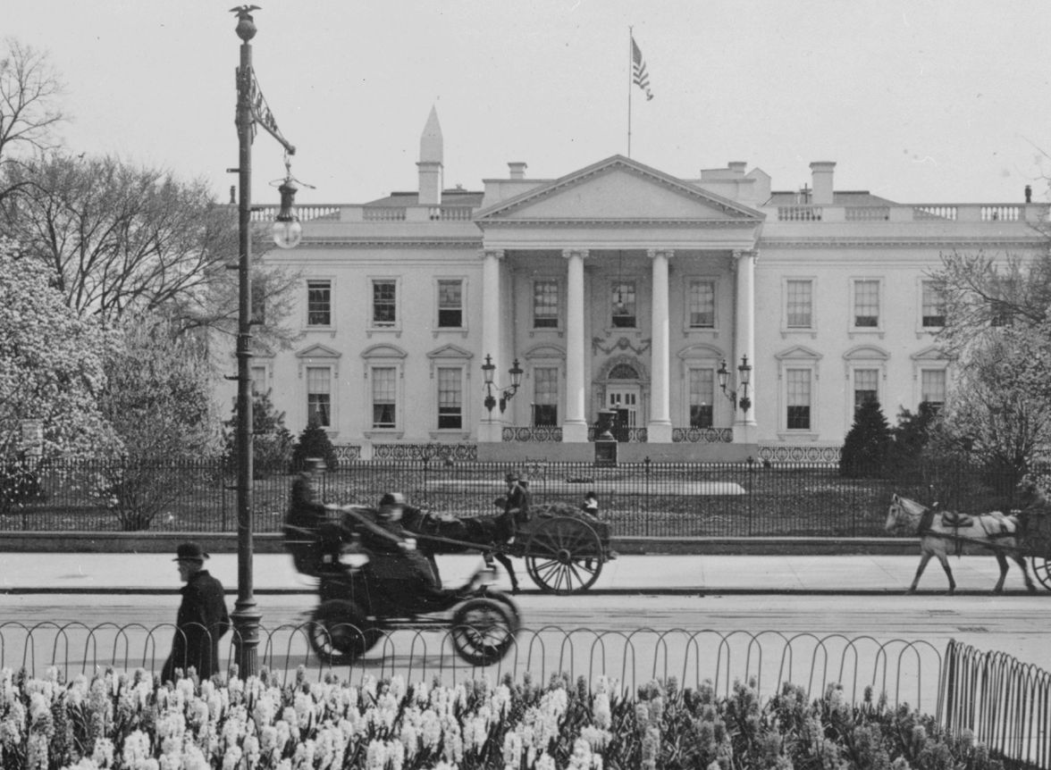 A photo taken in c.1906, showing an electric car and horse ...1920s White House