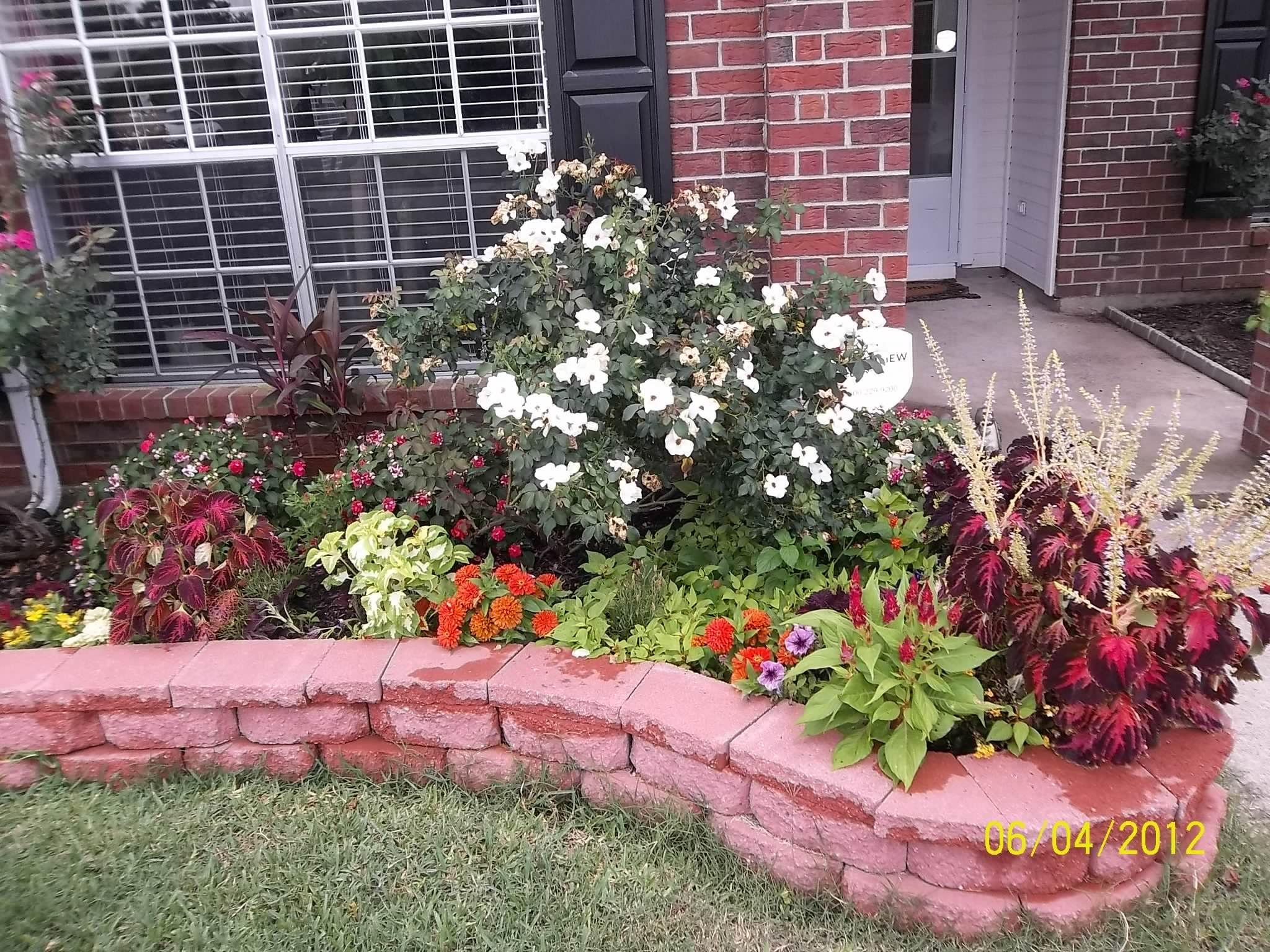 Flower beds for our big tree in the backyard description for Front flower bed landscaping ideas