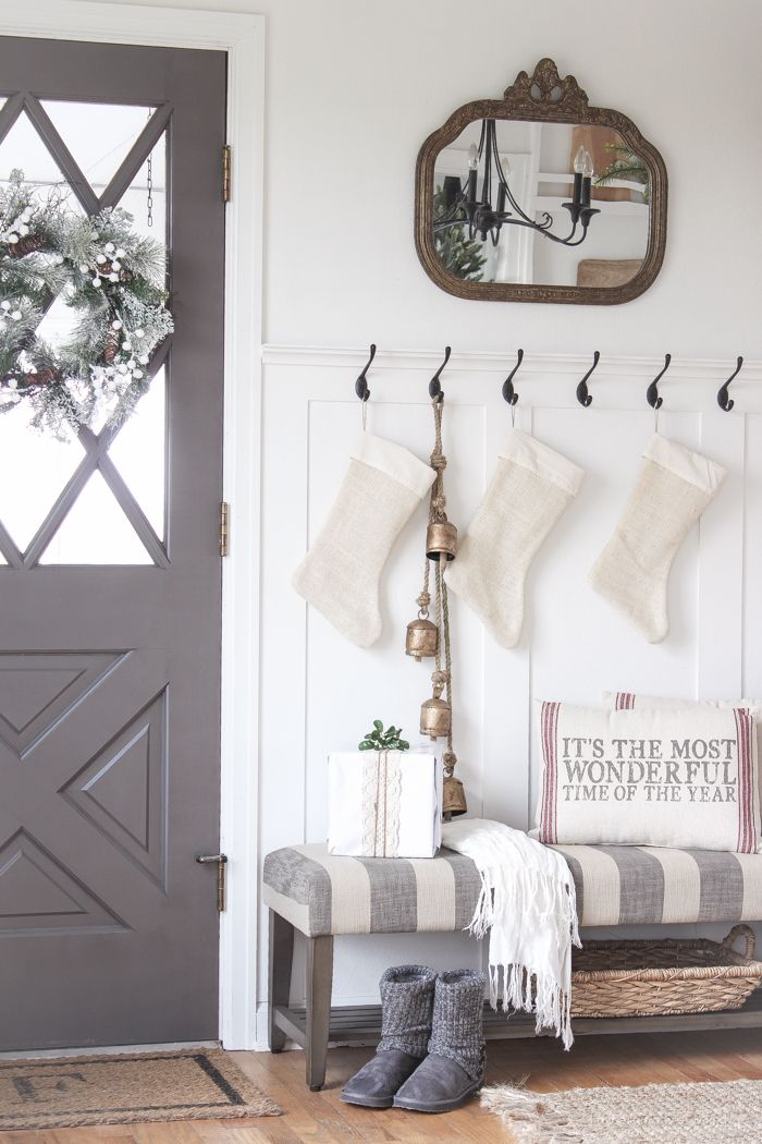 A Beautiful Farmhouse Entryway Decorated For The Holidays