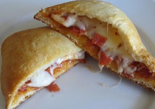 Crescent Pizza Pockets. Saw a Pillsbury commercial showing how to make these - super easy and delicious looking! Buy crescent rolls, put pizza toppings - mozzarella cheese and pepperoni - on each slice and fold in half. Yum!