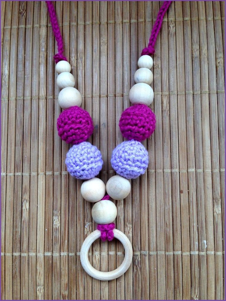 Collar porteo y lactancia 4Bolas Lila-Morado. http://www.portakanguritos.com/portakanguritos/5254091/collar-lactancia-y-porteo-4bolas-%28ver-modelos%29.html