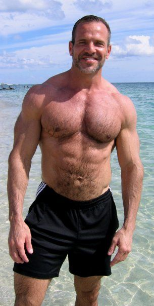 Muscular hairy chested men