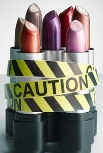 Photo of lipstick with hazard tape wrapped around it
