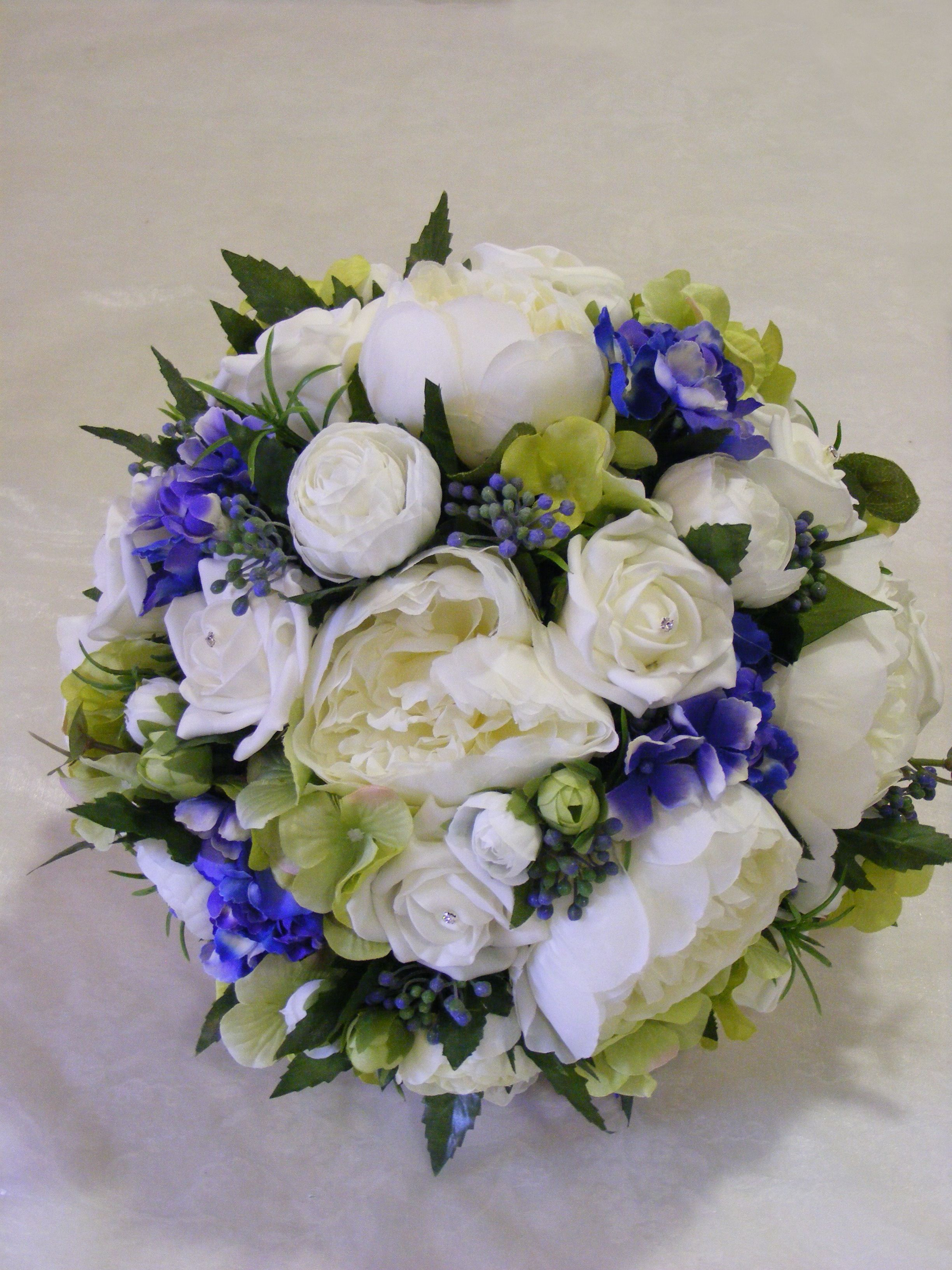 Love this bridal bouquet that we designed in everlasting flowers love this bridal bouquet that we designed in everlasting flowers fabulous cream blue and green flowers peonies roses hydrangea muscari and a touch of izmirmasajfo