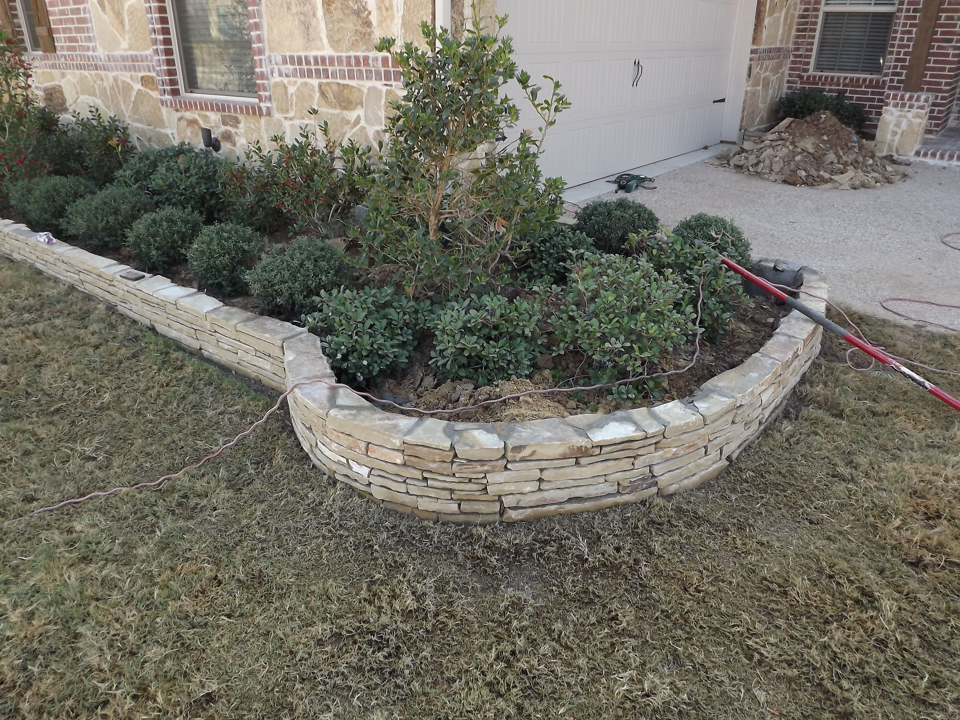 Stacked stone flowerbed edging trophy club tx 2012 2 for Rock garden edging