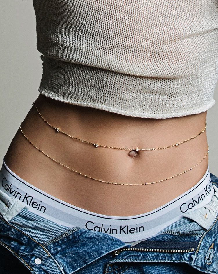 c1fdfced75d Dainty gold belly chains layered with denim and a crop top. @amyojewelry