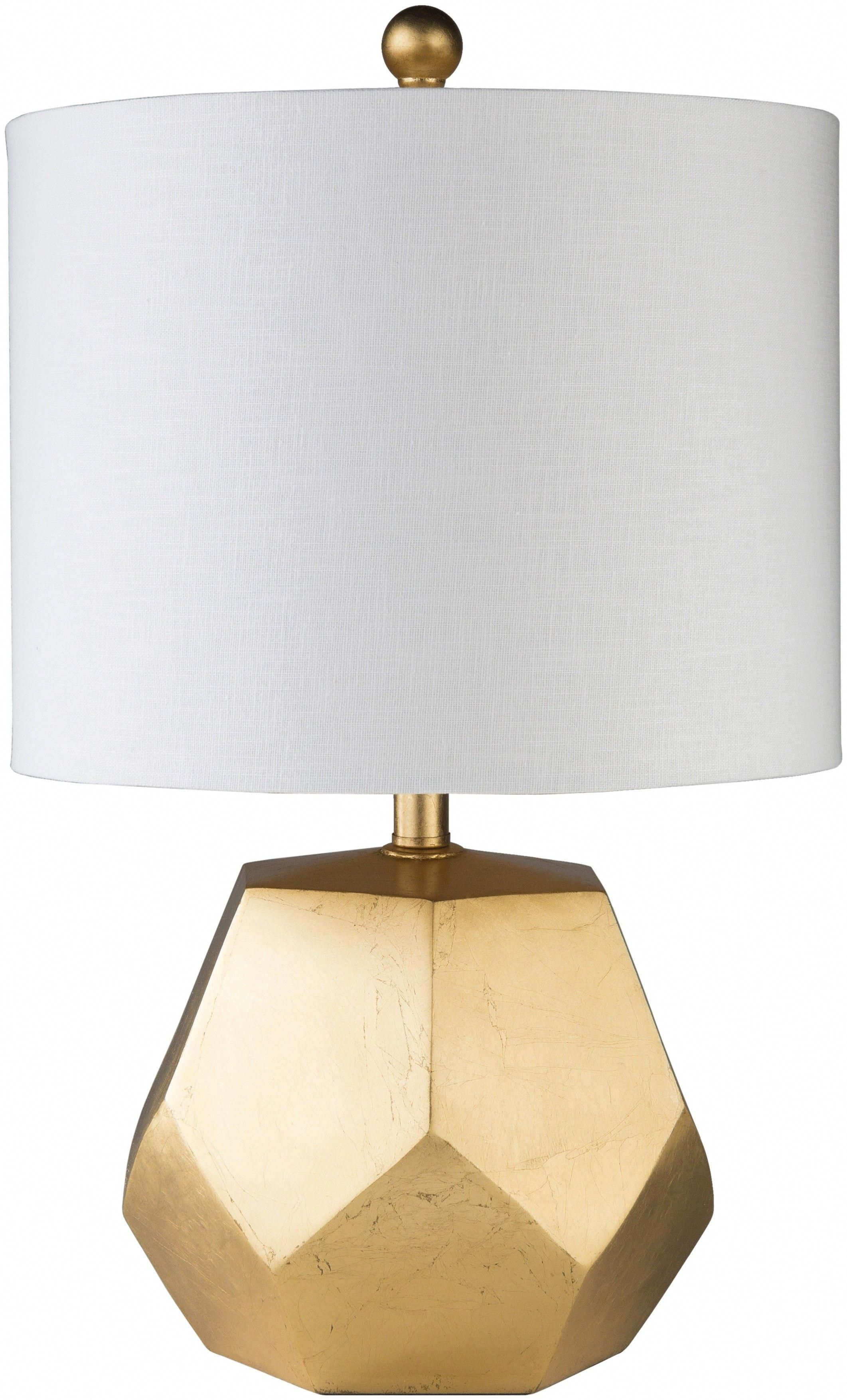 This faceted table lamp in bright gold will bring dimension and