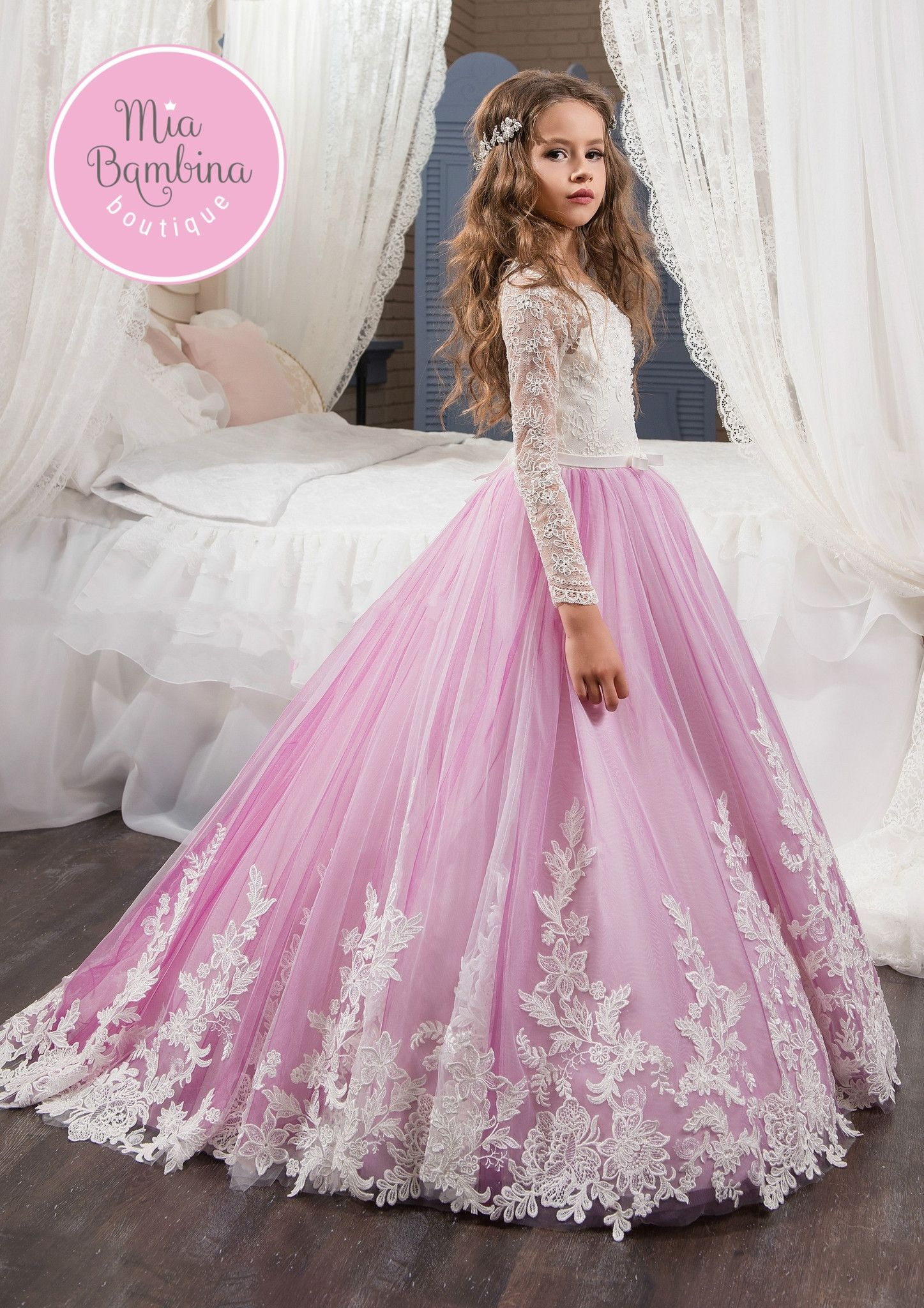 55d4a330b6 The breathtaking Atlanta is a Flower Girl ball gown with long lace sleeves  and full tulle skirt of contrasting color. The stunning floral ornaments  decorate ...
