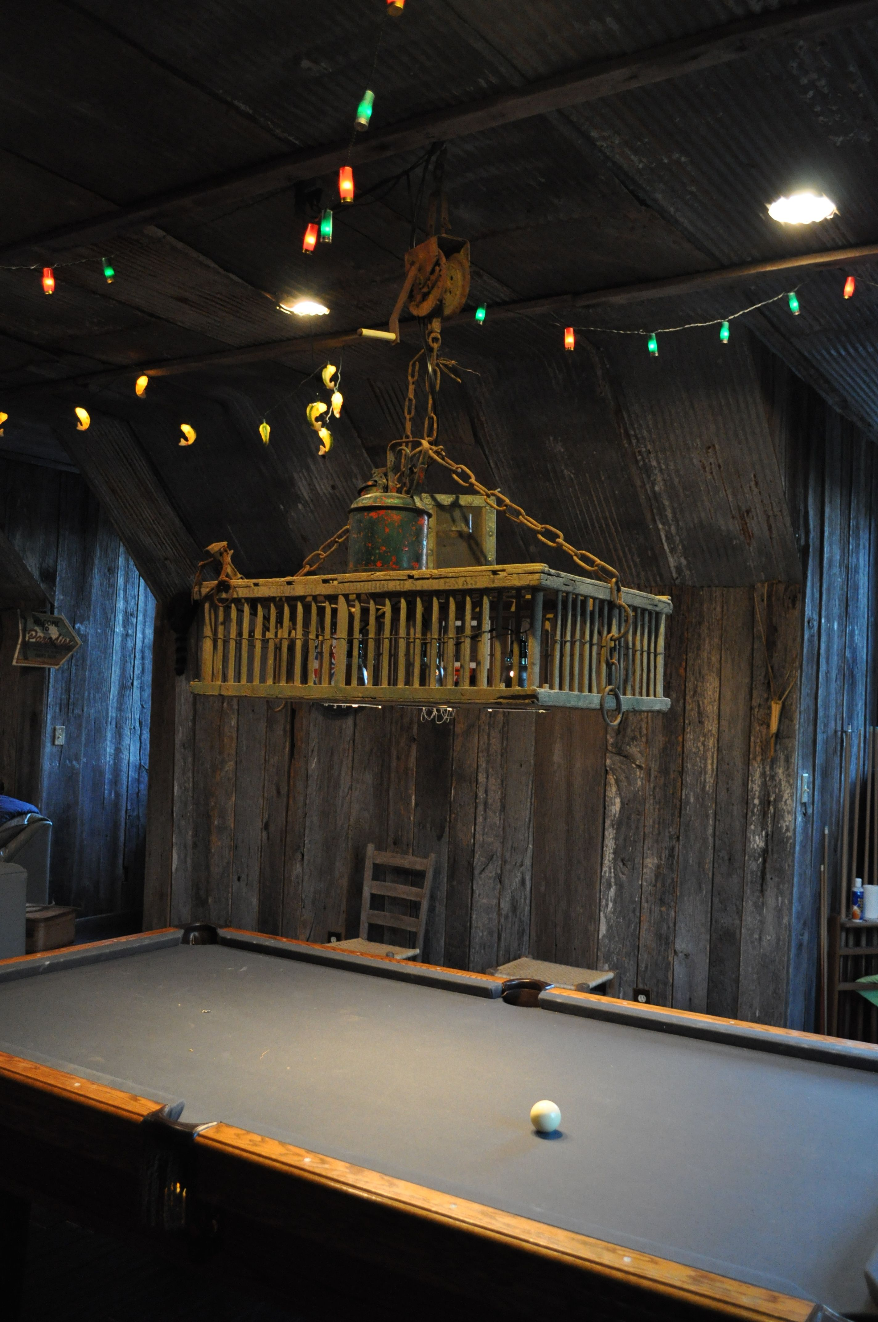 pool table light made from an old chicken coop