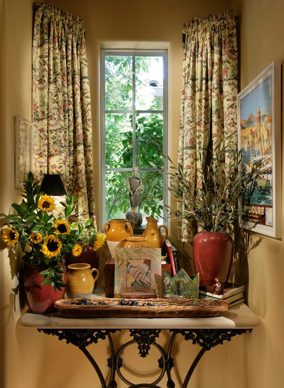 A French window box with antique collections of French Pottery.