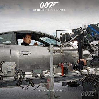 Pierce Brosnan (James Bond) gets ready for a close-up in the Aston Martin V12 Vanquish on the ice lake set of DIE ANOTHER DAY (2002)