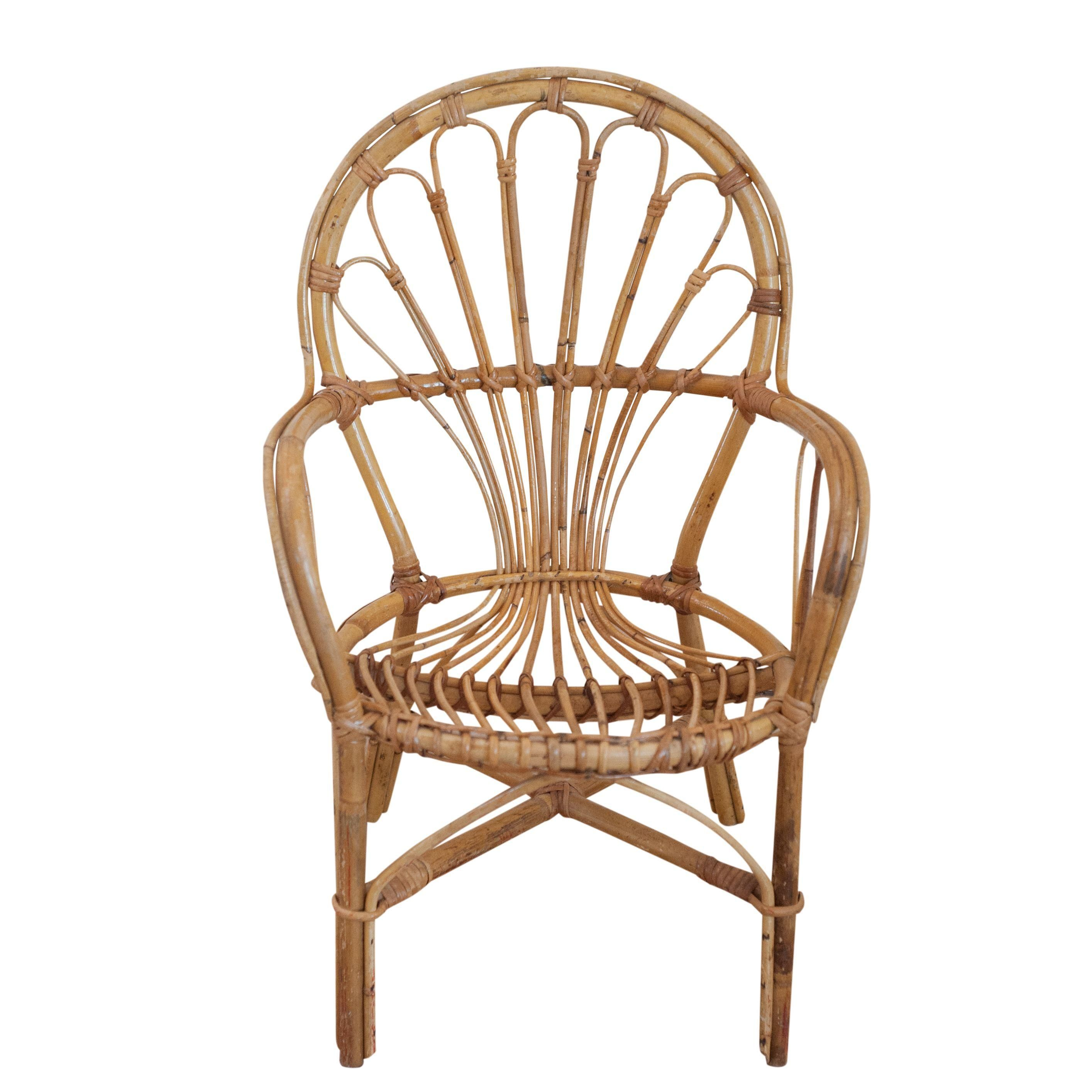 A great rattan child\'s chair, in the style of Franco Albini. This ...