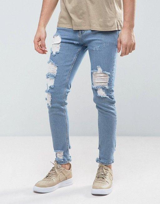 Compra Vaqueros ajustados con lavado claro azul vintage y roturas marcadas  de ASOS en ASOS. Descubre la moda online.