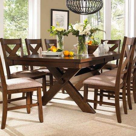 Sawhorse-style dining table with eight matching side c\u2026 Home