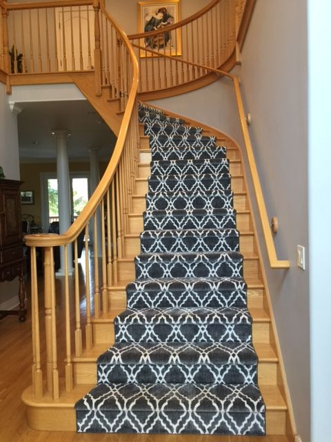 Grey Stair Runner. Patterned Stair Runner. Wooden Spindles And Bannisters.  Carpet On Stairs